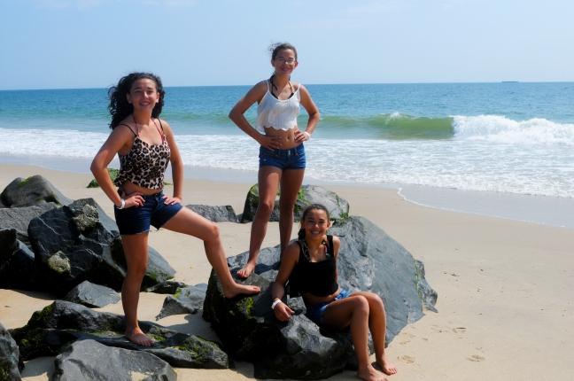 three girls on rocks